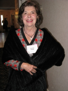 Style Show chairperson Carolyn Klinger models the fur shawl from Day Furs which went to a lucky guest at the event.