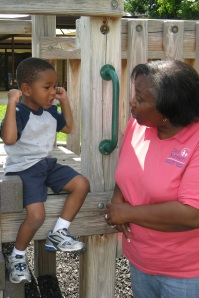 Director of Operations Marsha Lindsey visits the Day Nursery Ruth A. Lilly Center playground.