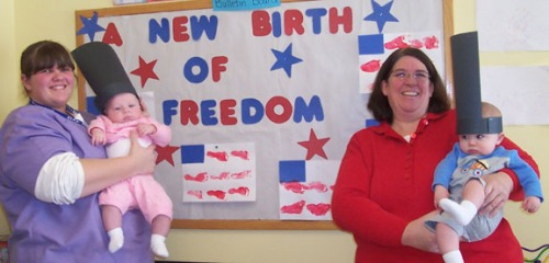 Infant teachers Krystal Gardner (left) and Cheryl Knierim even got their little ones into the fun of Inauguration Day by making footprint flags.