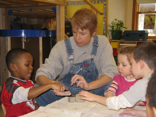 Young Audience's teaching artist Meg Olsen with Day Nursery children at Ft. Harrison.
