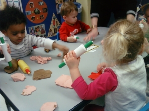 Day Nursery Hendricks County students work with homemade fun dough scented with instant coffee.