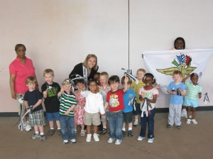 Jennifer poses after the parade with the Preschool 2 class