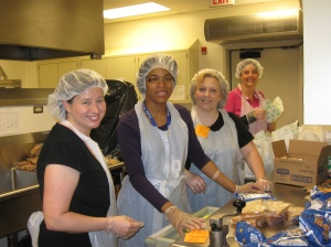 Center Directors preparing the meals for the family event.  (L to R: Sarah Parks, Federal Center; Debra Ballard, Ft. Harrison; Deanna Saylor, State Center and Marti Thiery, State Center