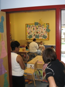 Volunteers from The Women's Fund take a peak into a Day Nursery classroom.
