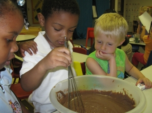 "Mixing up the chocolate to make ""dirt"" pudding"