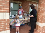 Ms. Chris served snow cones to the children as they left the center on Friday afternoon.
