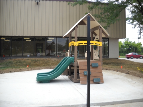 This equipment is sized for toddler play.  The infant toddler playground will have a poured rubber surface around the equipment when it is complete.