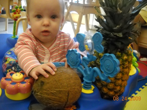 Ashylnn was surprised when given a coconut and a pineapple to play with