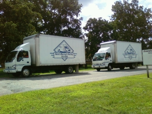 The moving vans leaving the Day Nursery at 56th and Guion are heading to our new location