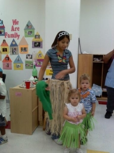 Miss Candice tries to get these two-year-olds in the party spirit