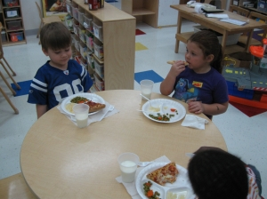 Pre-K enjoying Pizza Party earned for returning entire classes' parent survey
