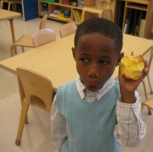 This preschooler from the Day Nursery at Ft. Harrison was surprised even though he had taken many bites, he had not found any seeds in his apple.