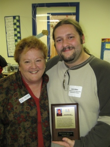 Day Nursery Executive Director Carolyn Dederer congratulates Matt following the annual meeting.