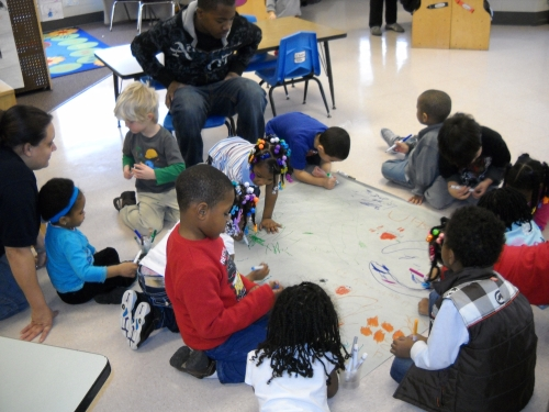 Children working on Kwanzaa mural