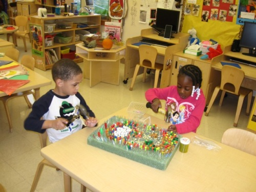 Day Nursery Indianapolis preschoolers working on art project