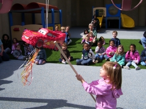 Day Nursery Indianapolis children on playground with pinata
