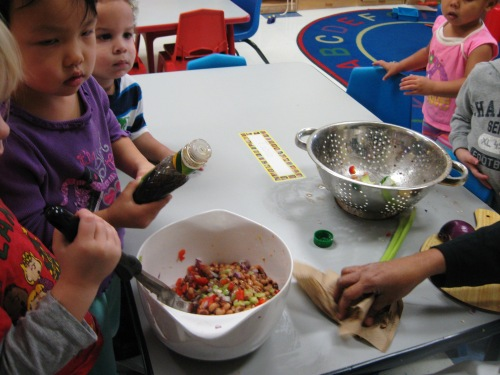 Children making Kwanzaa salad