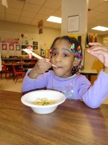 Day Nursery girl eating rice