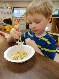 Day Nursery student eating rice