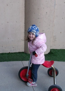 Child on tricycle on Day Nursery playground