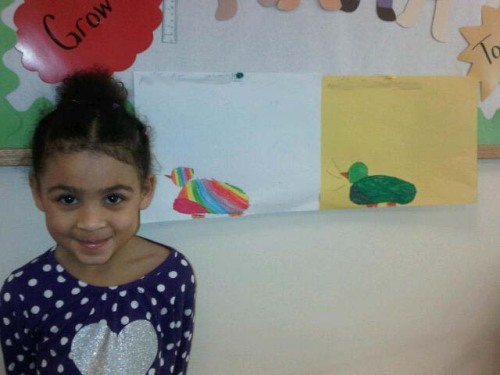 Day Nursery student with bird artwork