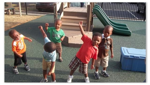 Toddlers exercising on playground