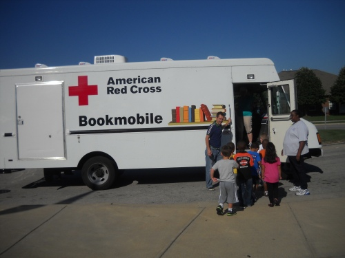 Children board the Red Cross bookmobile