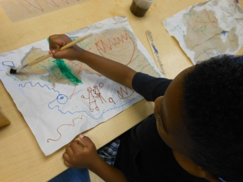 Day Nursery student making a treasure map