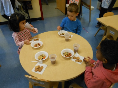 "Day Nursery students enjoy ""stone soup"" at snack time."