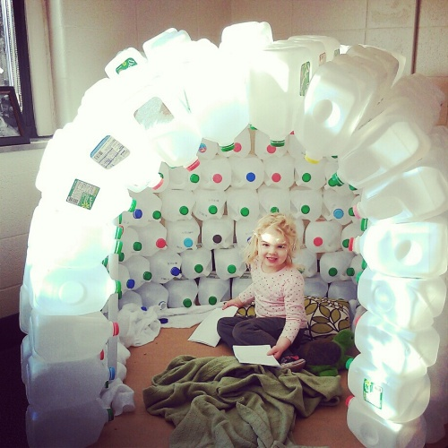 Day Nursery preschool student in igloo made of milk jugs
