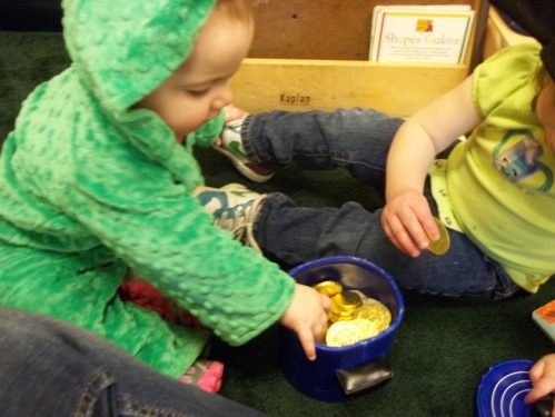 "Day Nursery toddlers playing with pot of ""gold"""