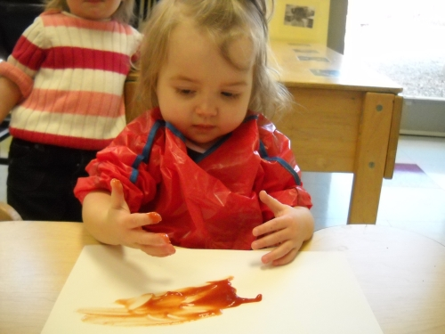 Bethany painting with ketchup