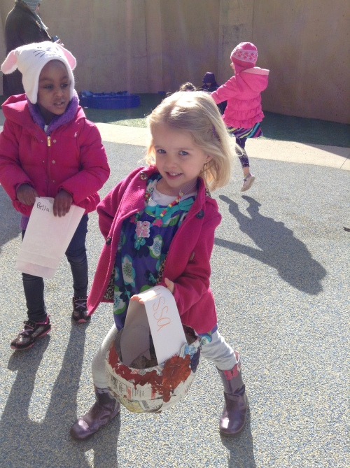 Day Nursery student shows off her Easter basket during egg hunt on the preschooler's playground.