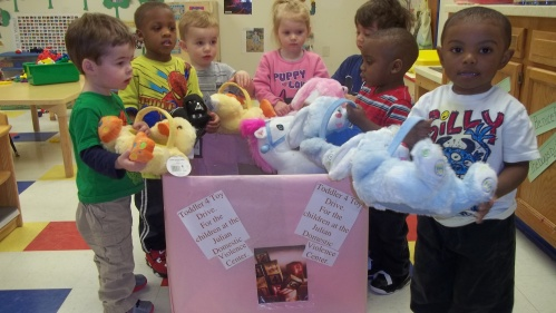 Day Nursery Indianapolis toddlers with toys they collected to donate to Julian Center